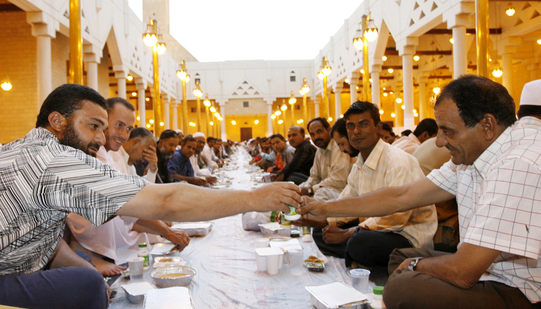 Foreign workers gather for a mass feast at the end of the first day of the Muslim fasting month of Ramadan in Riyadh